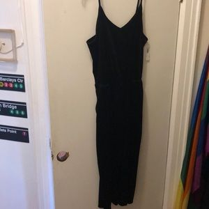 Black velvet jumpsuit. New with Tags